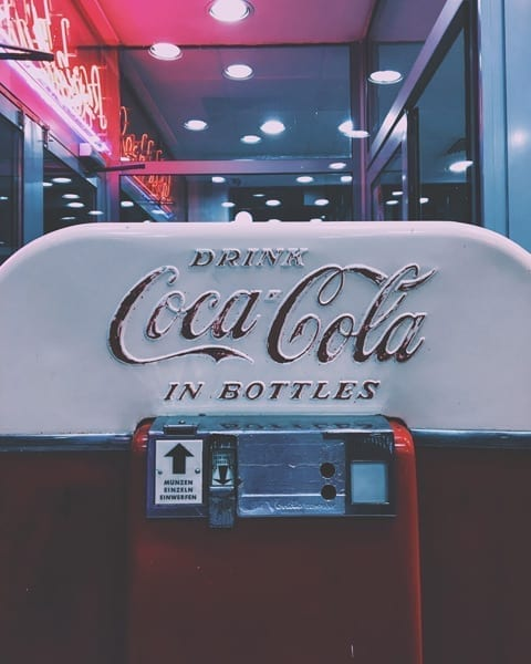 coca cola logo on machine
